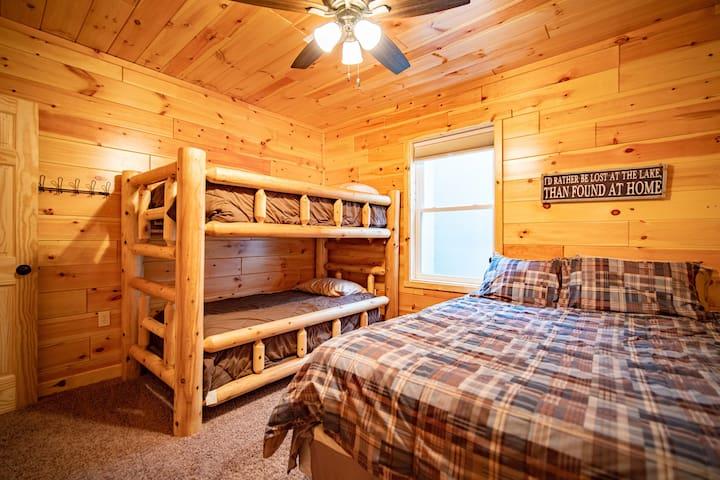 Lower level bedroom - queen bed, twin bunks.