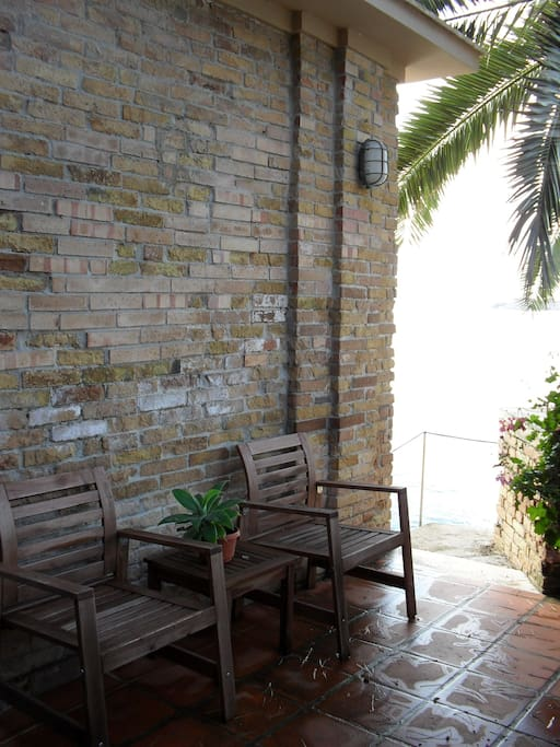 A stairway leads from the main terrace to the studio's private terrace.