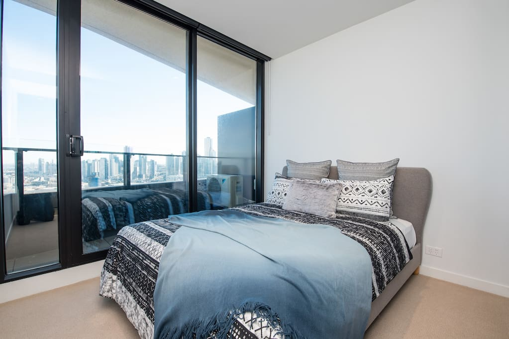 Master bedroom with view and mirror wardrobe