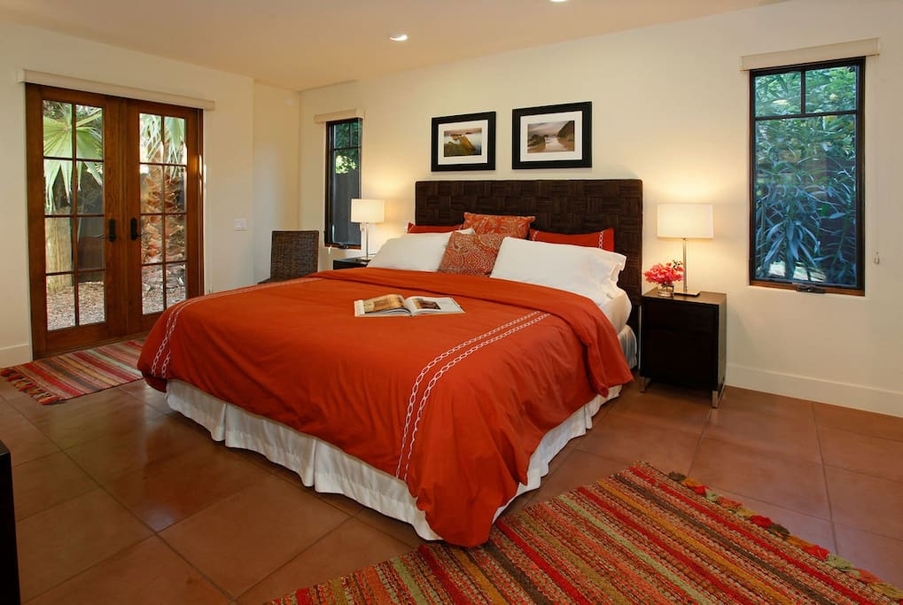 The 1st floor Master Suite opens to private patio