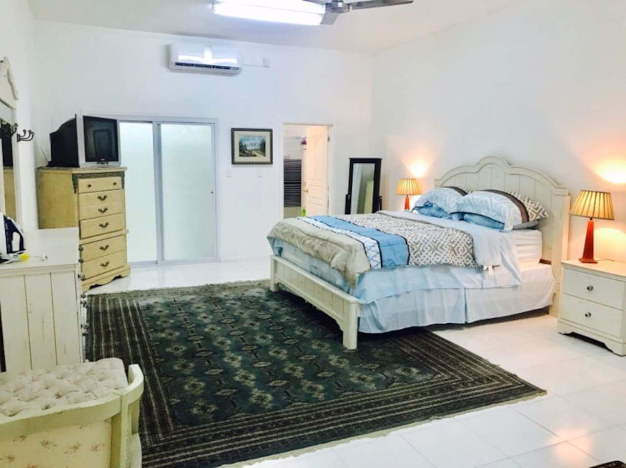 Large Master bedroom with ensuite and walk in rope.  Huge king size bed and aircon.