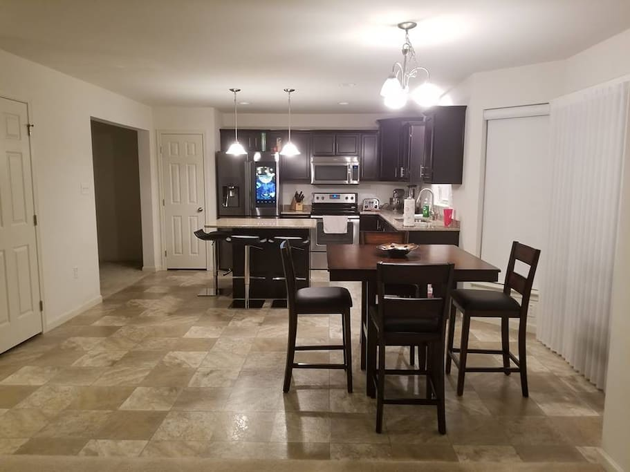 Huge open kitchen with dimming/brightening lights, top of the line cookware and Samsung smart refrigerator. Plenty of dishes and lots of space for you and your family to sit and enjoy a quick bite or morning coffee.
