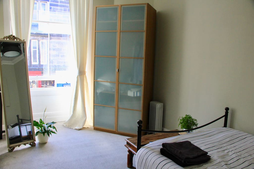 Bright bay windows and storage space in double bedroom