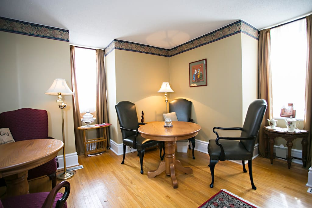 This cosy dining room seats 8 . Relax in  this multipurpose room  with a  fireplace, television &  DVD  player.