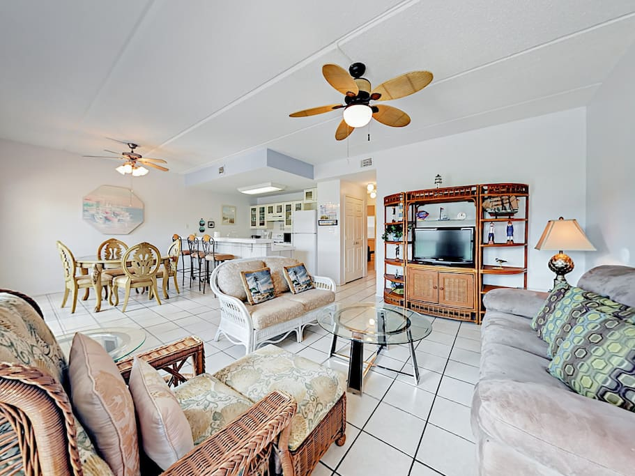 There's plenty of comfy seating in the light-filled living area. Professionally cleaned and maintained by TurnKey Vacation Rentals.