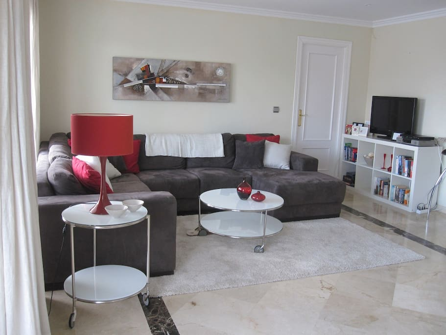 The sitting area with comfortable couches, TV etc