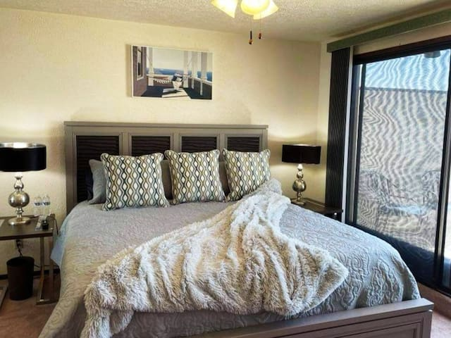 Second story master suite, 2 walk in closets, cedar lined drawers, with luxe bedding and lighting. Smart TV and cable.