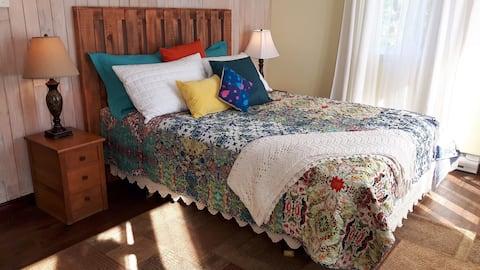 Private guest suite, large bedroom, spa bath.