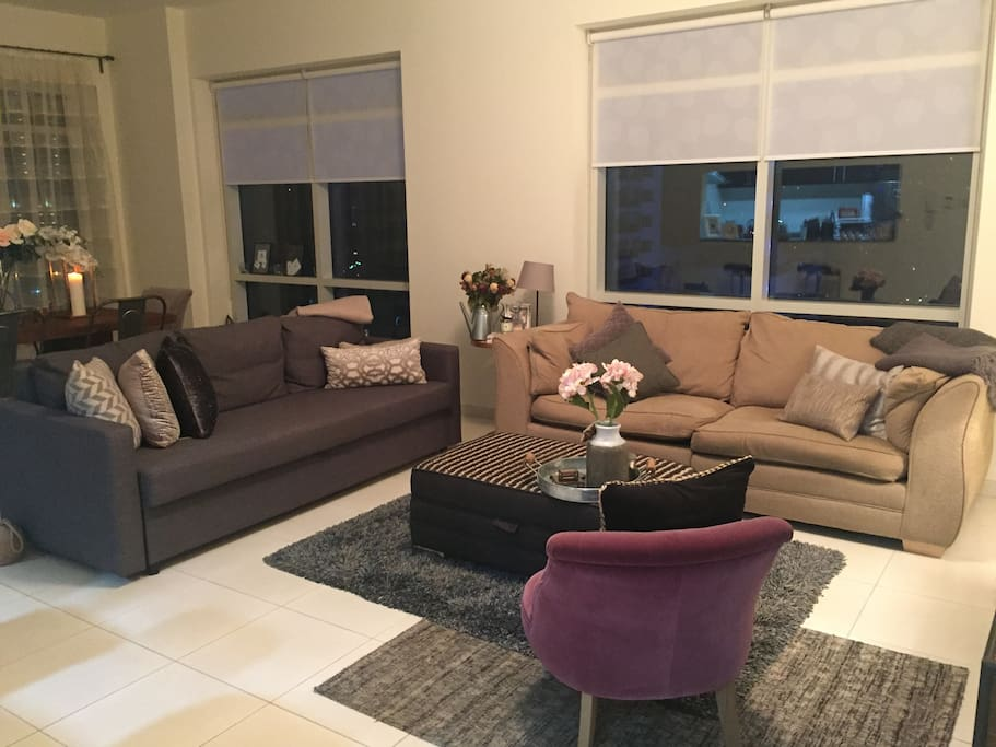 Bright lounge/dining room with comfy sofa's (one sofa bed) and TV.  Floor to ceiling windows overlooking the Marina.