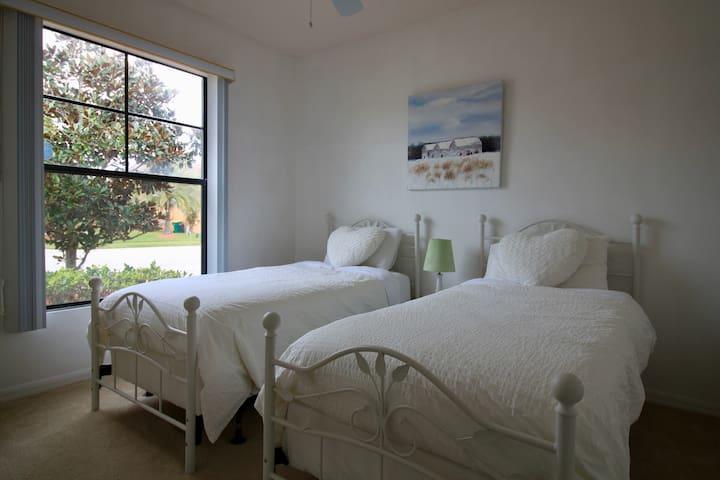 Twin beds in bedroom 3.