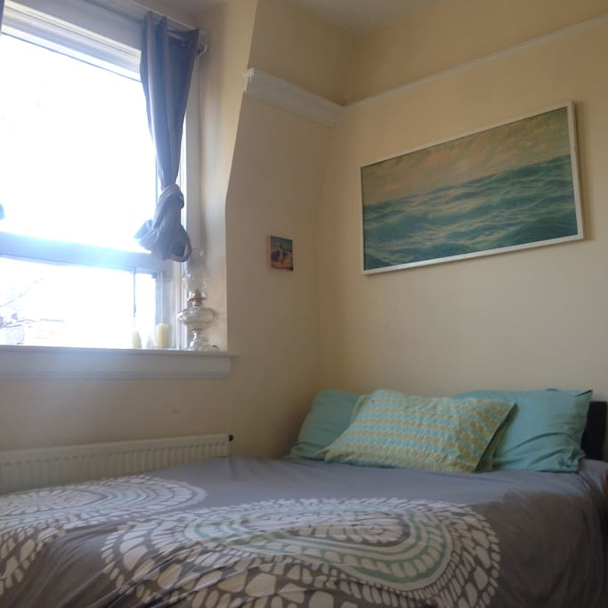 Comfy double bed, lots of light.