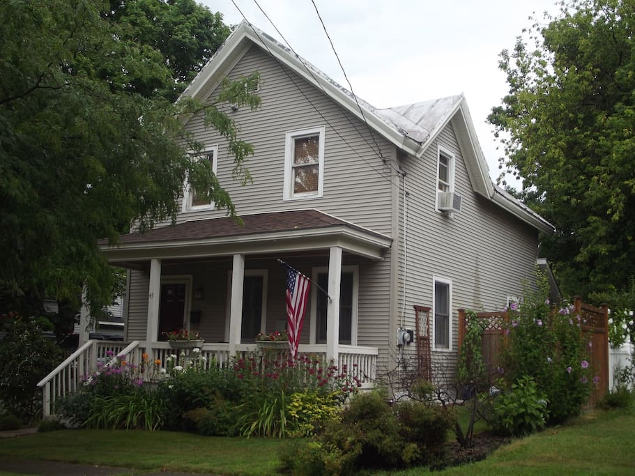 Two story house on quiet residential street.