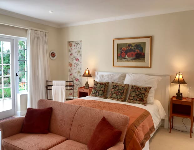 A spacious suite with french doors leading onto private patio