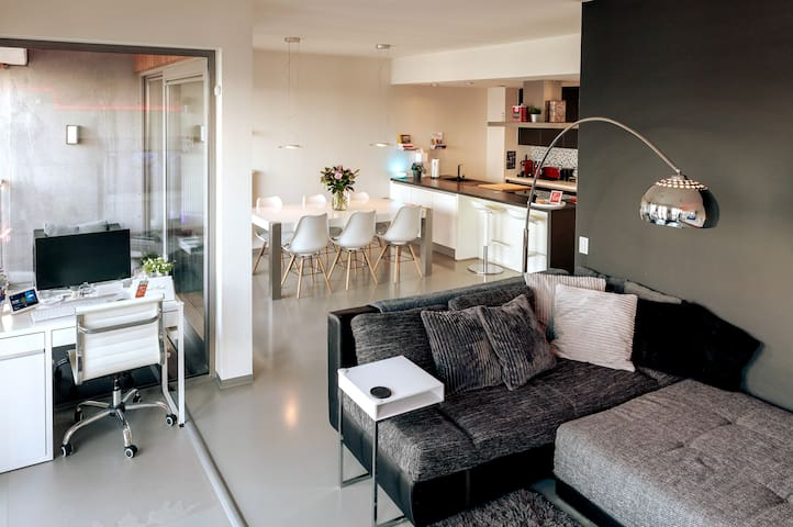 Living room opens onto dining area & covered terrace