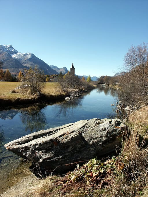One of the Churches in Sils with the River Inn. Autumn is a great Time for Hiking in the clolorfull Larch-Forests. The gorgeous Nature and changing Atmosphere is what makes this Place so unique