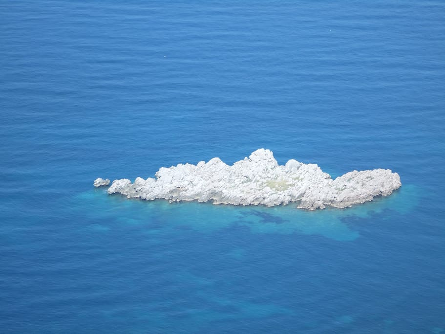 A small island that overlooks studio Honeymoon.