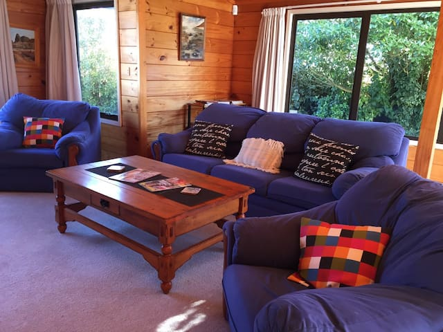 Lounge with cosy sofa and seats. There is also a Thomas The Tank Engine set hidden away in a toy box behind the sofa - plenty of space and nooks for young children to play in.