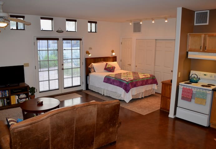 Looking into bedroom area with queen-sized bed.