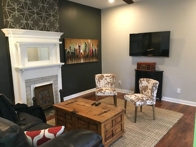 """Hang in the cozy living room and watch a movie on the 75"""" 4K TV"""