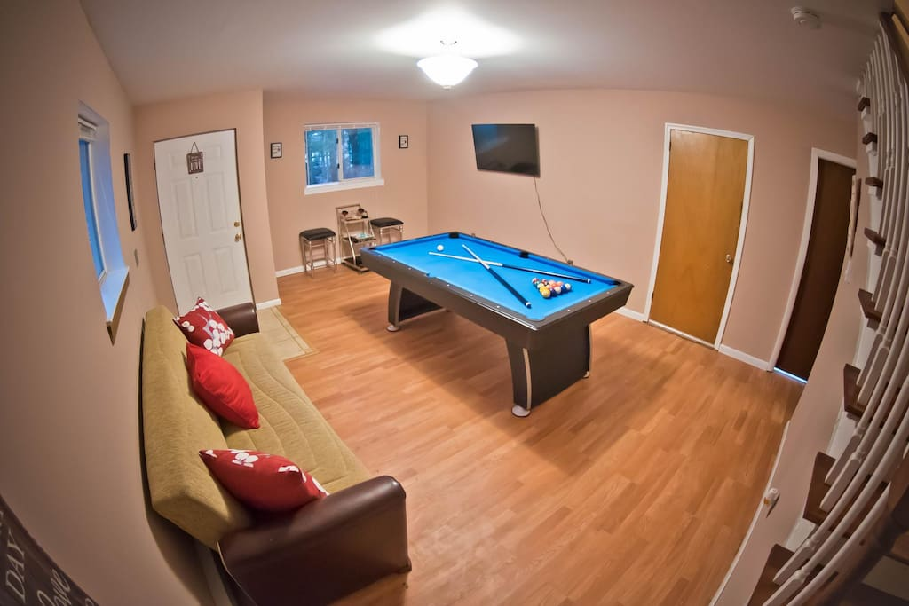 Lower Level Game Room with Pool Table and a Cozy Couch