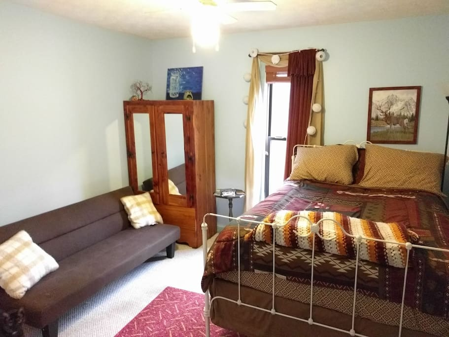 Your bedroom features a full size bed, a small futon, adjustable lighting, closet, ceiling fan, and optional window fan.