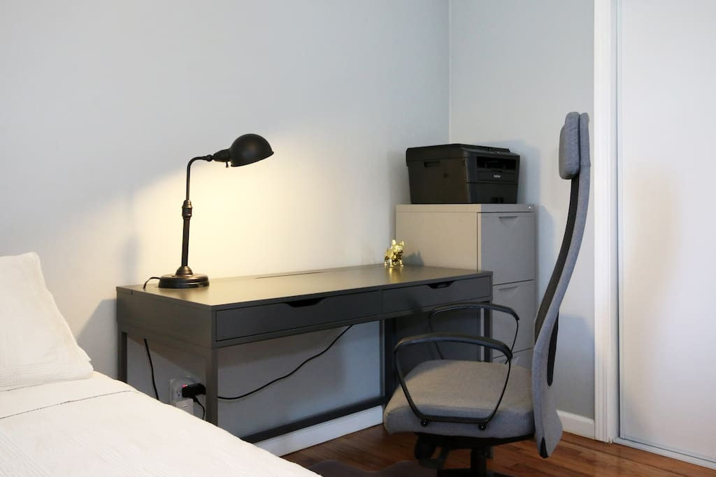 Desk with rolling chair.