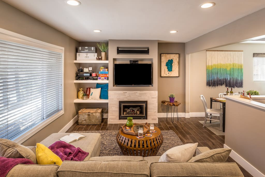 The living room has plenty of seating to enjoy the HDTV or the gas fireplace.