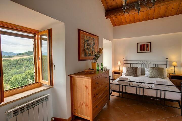 Bedroom 1 with views of the vineyards