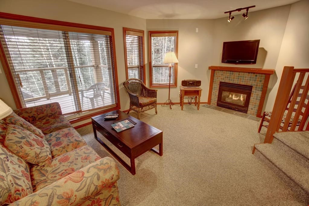 Comfy and cozy living room with private fireplace.
