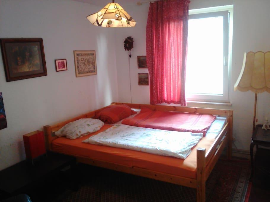 Bedroom with big bed with a german cuckoo clock