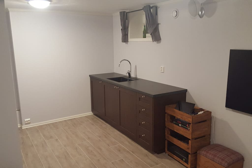"""Half"" kitchen with sink and refrigerator. Water boiler and coffee machine available"