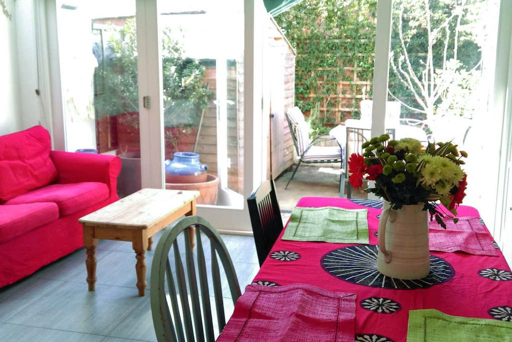 Lovely patio garden seen through kitchen doors that are fully open from side to side in summer