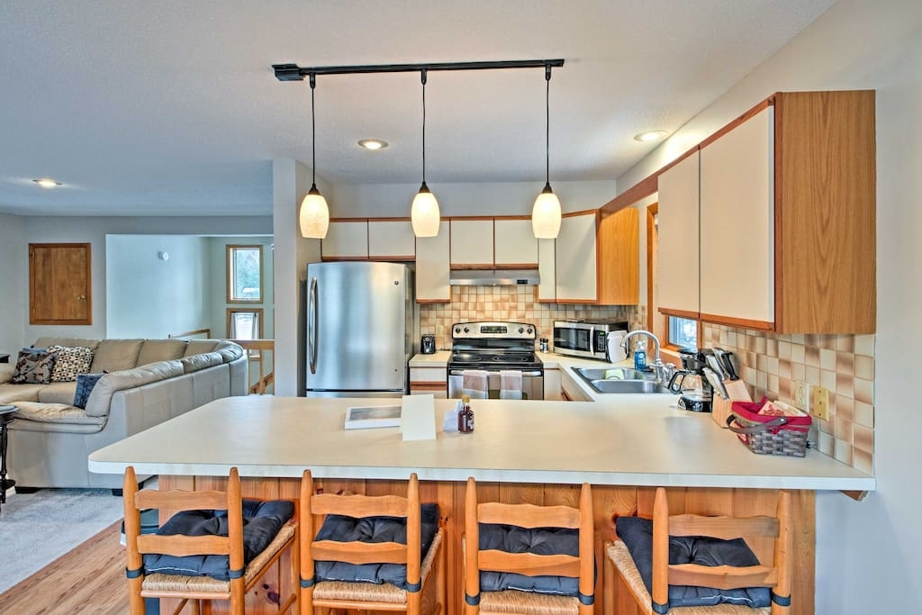 This spacious 1,454-square-foot property offers all of the home essentials along with a wood-burning stove, open concept living room, and views of the Rocky Branch River.