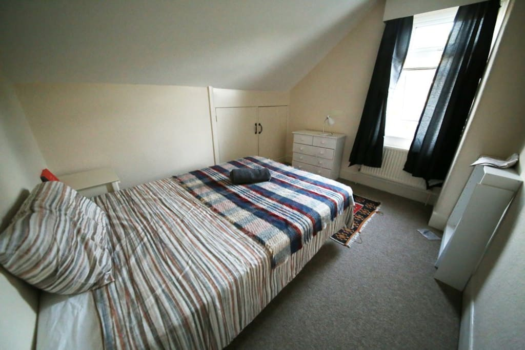 top floor double bedroom with garden view