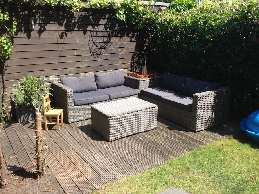 comfy and sunny lounge area in backyard