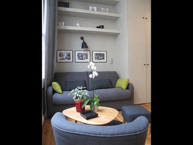 Cosy sitting area with wall to ceiling cupboards