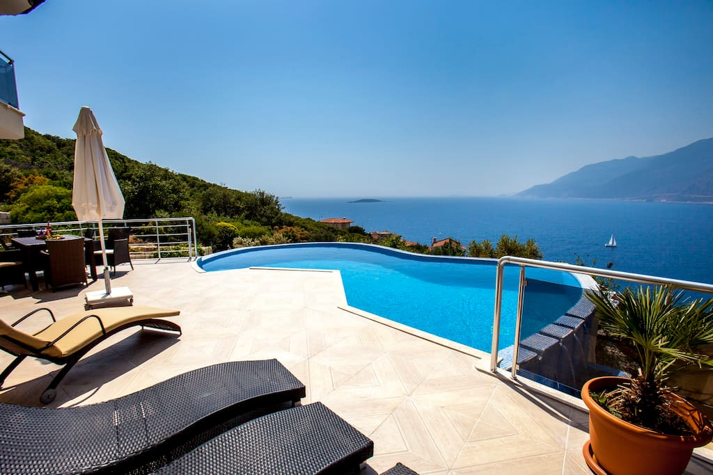 Terrace with 6 sunbeds and sun ambrilla and table with chairs for 8 people.