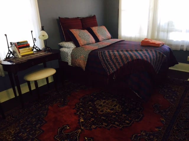 Comfortable full-size bed for two, writing desk, western and northern windows with Bali blinds for privacy, Persian carpet...