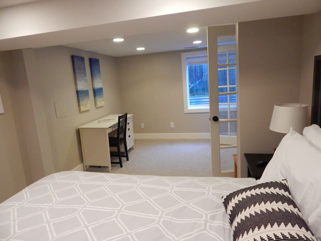 Large bedroom space and desk area