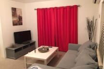 Living room with pullout sofa and 40'' television