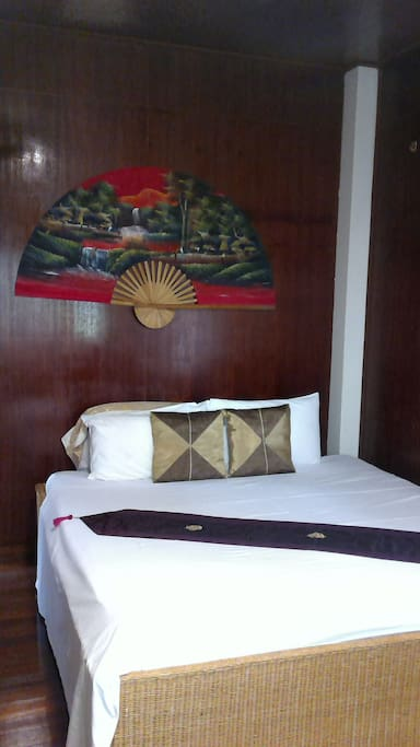 the guest room on the upper floor, traditional style - but with fan and aircon