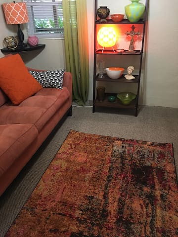 Colorful area rug in living room.