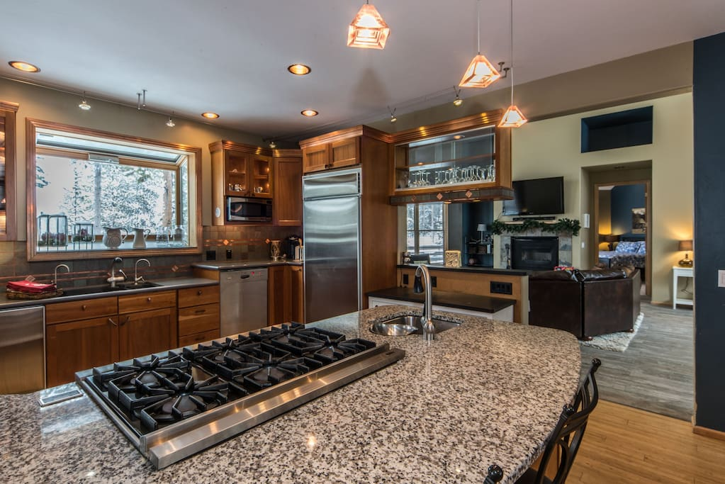 Large kitchen with viking stove open to the living area.