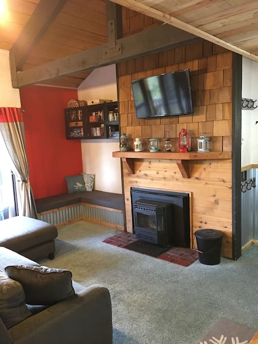 Main room with TV, VCR, DVD, playstation and Pellet Stove