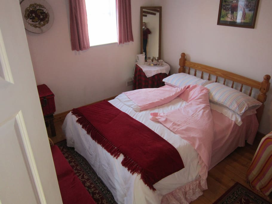 Double bed with plenty of room to add a single bed if required