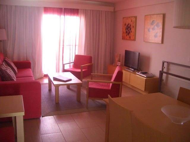 Livingroom with bed-settee for two, table and chairs for 6 persons, TV, hdmi, Radio/CD,