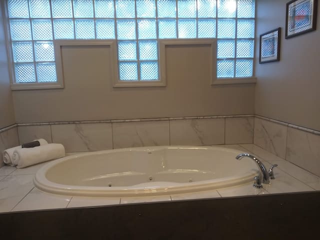Jetted Jacuzzi Tub, great for relaxing after along day of hiking or sight-seeing in the city.