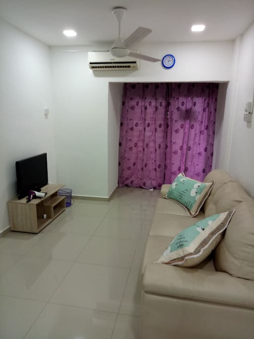 living room with 1 sofa bed, 1 single bed, tv, wifi, air-conitioning, ceiling fan, dining table...
