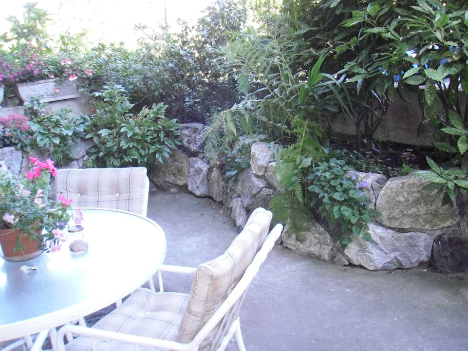 Private garden off living room is low maintenance.