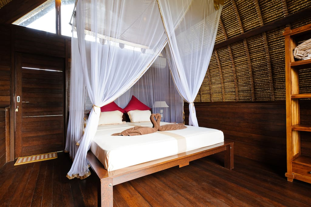 Double beds with mosquito net.